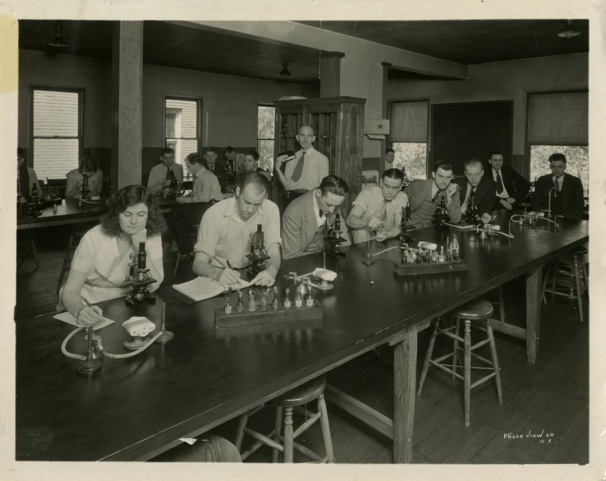 Adult students in laboratory.