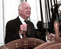 Walter Cronkite takes the helm of the USS Constitution 21 July 1997.